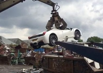 PAY-FOOTAGE-OF-FERRARI-BEING-CRUSHED-IN-SCRAPYARD